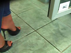 Filling the fridge  high heels and tight jeans