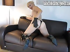 horny blonde teasing and wanking pussy in leather gloves and sexy lingerie