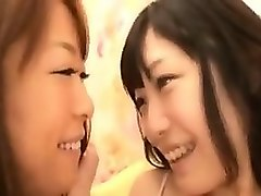 two striking asian babes drop their clothes and engage in l