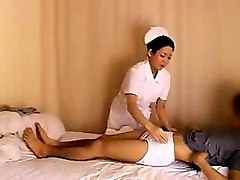 naughty oriental nurse gives a horny patient the treatment