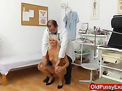 doctor inserting toys in blonde shaved pussy while doing checkup